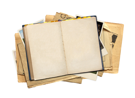 vintage photo: Old book and photos. Objects isolated on white background