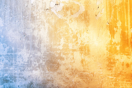 Grunge background with texture of stucco blue and ochre color Stock Photo