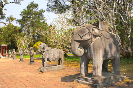 mang: Stone statues of horse, elephant and people in Imperial Minh Mang Tomb of the Nguygen dynasty in Hue, Vietnam.