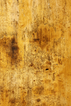 stucco texture: Grunge background with texture old stucco of ochre color