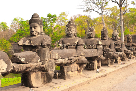 bayon: Giants guardians in Front Gate in Prasat Bayon Temple, famous landmark Angkor Wat complex, khmer culture, Siem Reap, Cambodia