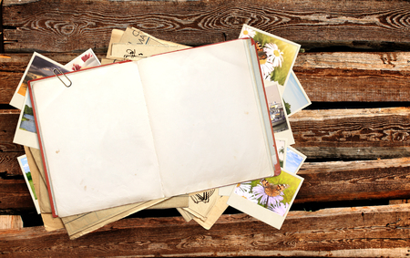 diaries: Old book and photos on wooden planks Stock Photo