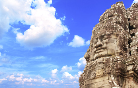prasat bayon: Giant stone face in Prasat Bayon Temple, famous landmark Angkor Wat complex, khmer culture, Siem Reap, Cambodia