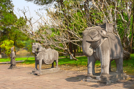 mang: Stone statues of horse, elephant and man in Imperial Minh Mang Tomb of the Nguygen dynasty in Hue, Vietnam.