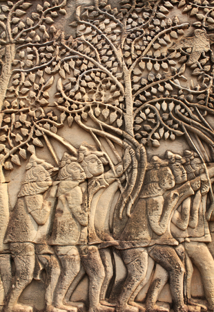 prasat bayon: Wall carving with archers, of Prasat Bayon Temple, in famous landmark Angkor Wat complex, khmer culture, Siem Reap, Cambodia
