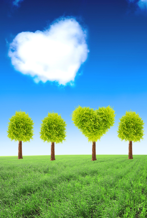 cloud shape: Heart shape tree on green field and one cloud on blue sky background