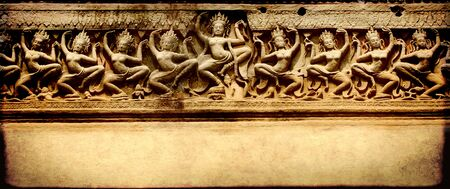 khmer: Grunge banner with carving with dancers of Preah Khan Temple, in famous landmark Angkor Wat complex, khmer culture, Siem Reap, Cambodia
