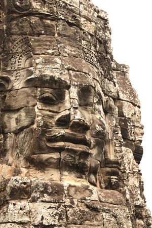 prasat bayon: Giant stone face in Prasat Bayon Temple, famous landmark Angkor Wat complex, khmer culture, Siem Reap, Cambodia. Isolated on white background