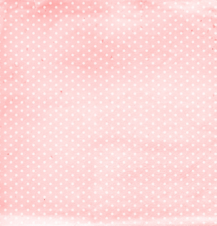 Grunge background with dots pattern and paper texture of pink color