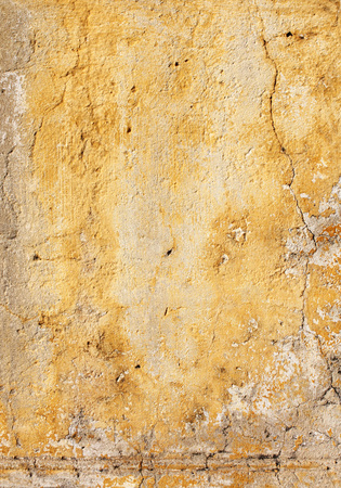 wall texture: Grunge background with old stucco wall texture of yellow color