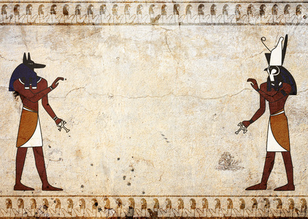ancient egyptian civilization: Grunge background with old stucco texture of beige color and Egyptian gods Anubis and Horus images  Stock Photo
