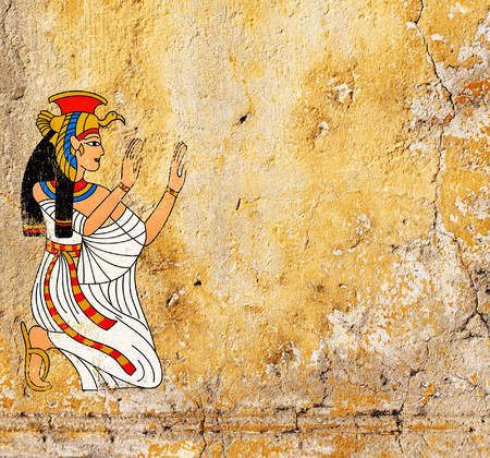Grunge background with old stucco texture of yellow color and Egyptian goddess Isis image  Stock Photo