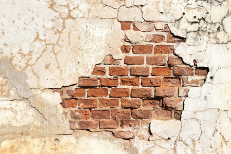 mottled: Grunge background with texture of old brick wall and cracked stucco of white color