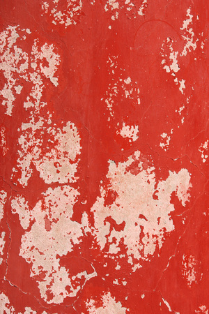 stucco texture: Grunge background with old stucco wall texture of beige color and cracked paint of red color