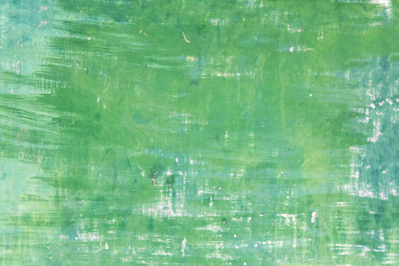 stucco texture: Grunge background with old stucco wall texture of beige color and cracked paint of green color