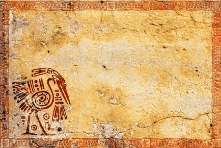 stucco texture: Background with grunge stucco wall texture of yellow color and American Indian traditional patterns with heron Stock Photo