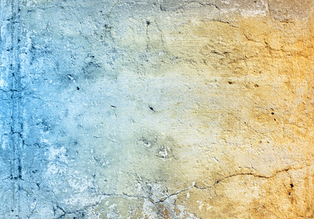 stucco texture: Grunge background with texture of stucco blue and ochre color Stock Photo