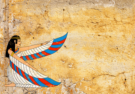 stucco texture: Grunge background with old stucco texture of yellow color and Egyptian goddess Isis image  Stock Photo