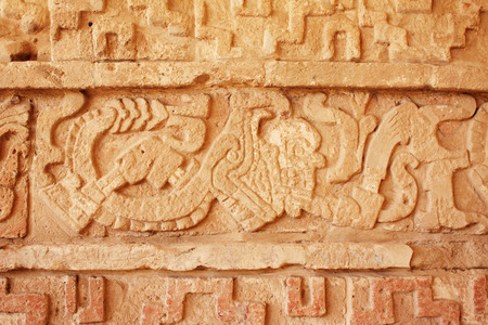 Grunge background with stucco texture and bas-relief carving of a snake, pre-Columbian Maya civilization, Tula de Allende, Hidalgo state, Mexico Stock Photo