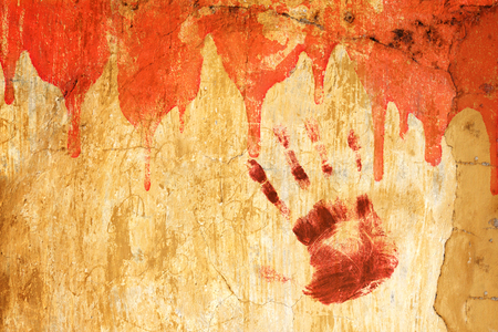 murdering: Halloween background. Blood and human palm print on stucco wall. Copy space for your text