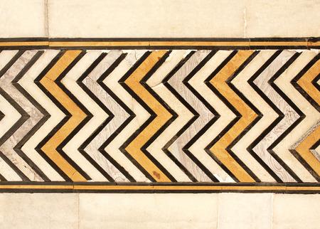 mughal: Ancient geometric ornament on marble in Taj Mahal mausoleum, Agra, India