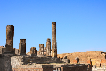 Ruins of Pompeii, Italy, Europe. Ancient columns. On blue sky background