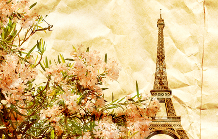 Grunge background with texture of old crumpled paper and famous landmark of Paris - Eiffel tower and pink flowers