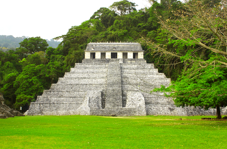 Temple of the Inscriptions - mesoamerican stepped pyramid structure at the pre-Columbian Maya civilization, Palenque, Chiapas, Mexico.