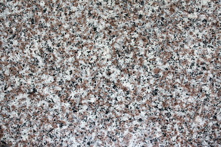Texture of granite of grey and brown colors Stock Photo