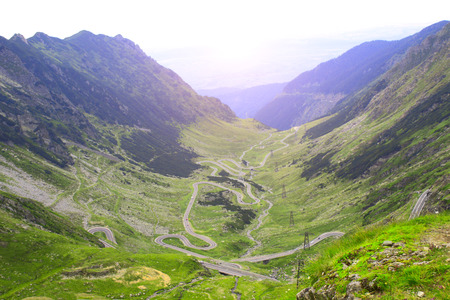 Top view on landscape with Fagaras mountains and Transfagarasan winding road (also known as Ceausescus Folly), Carpathians, Romania. Is included in the 10 most beautiful roads in the world