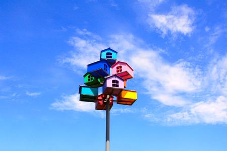 nesting: Colorful nesting boxes on blue sky background