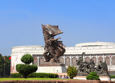 totalitarianism: NORTH KOREA, PYONGYANG - SEPTEMBER 20, 2017: Museum of Victory. Statue of a soldier with a flag at the entrance to the Victorious Fatherland Liberation War Museum. North Korea (DPRK) Editorial
