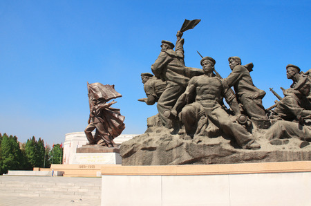 totalitarianism: NORTH KOREA, PYONGYANG - SEPTEMBER 20, 2017: Museum of Victory. Statue of a soldiers and sailors at the entrance to the Victorious Fatherland Liberation War Museum. North Korea (DPRK)