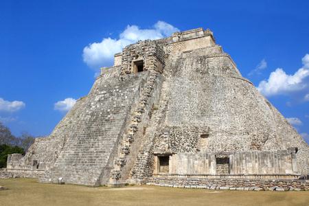 Ancient Mayan pyramid of the Magician in Uxmal with god Chaac masks (god of rain), royal complex, Yucatan, Mexico.