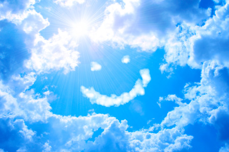 Smilie from cloud and bright sun in the blue sky  Stock Photo