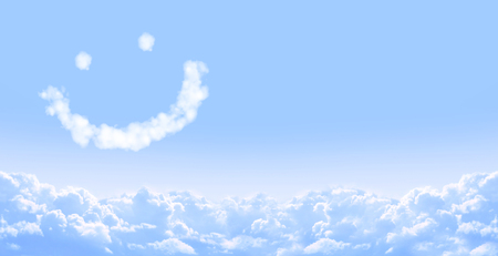 Horizontal banner with smilie from cloud and white clouds in the blue sky  Stock Photo