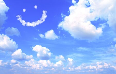 Smilie from white cloud in the blue sky