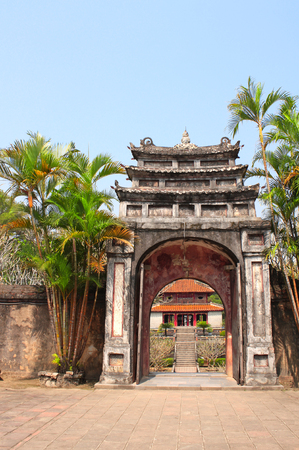 Ancient stone gate in Imperial Minh Mang Tomb of the Nguygen dynasty in Hue, Vietnam.