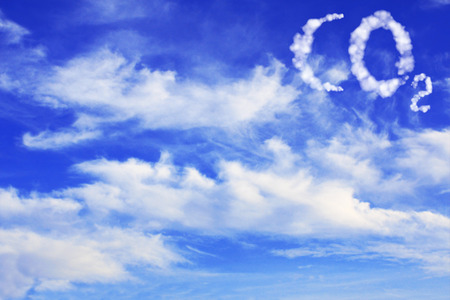 Symbol CO2 from clouds on blue sky background.