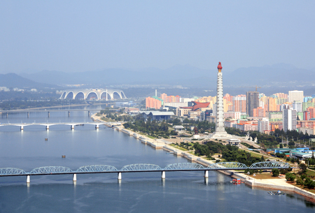 PYONGYANG, NORTH KOREA (DPRK) - SEPTEMBER 25, 2017: Aerial view of new residential complex, Tower of the Juche Idea and Daedong River (Taedong River). View from Yanggakdo island Editorial