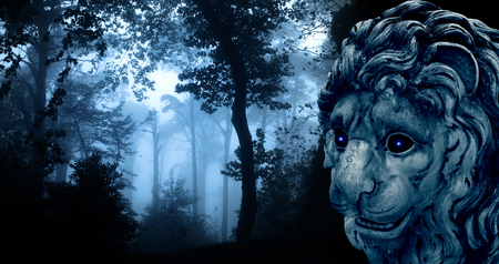 Ancient lion statue with glowing eyes in mysterious landscape of foggy forest