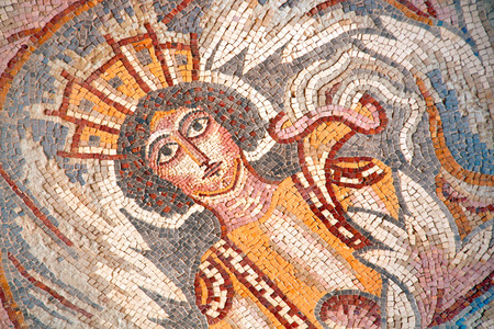 Ancient byzantine natural stone tile mosaics with face of mythical goddess and floral ornament, Madaba, Jordan 写真素材