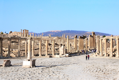 Oval Plaza with ionic columns in Jerash (Gerasa), ancient roman capital and largest city of Jerash Governorate, Jordan, Middle East.
