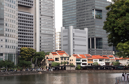 Old houses of the colonial period and modern buildings on the banks of the Singapore River, Singapore