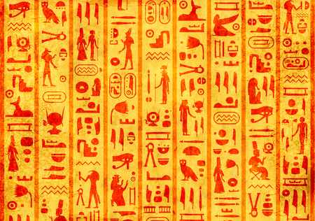 Grunge background with old paper texture of yellow color and ancient egyptian hieroglyphs and symbols Stockfoto