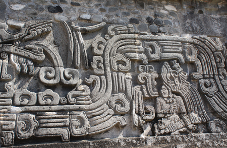 Bas-relief carving with of a american indian chieftain and god Quetzalcoatl, pre-Columbian Maya civilization, Temple of the Feathered Serpent in Xochicalco, Mexico.