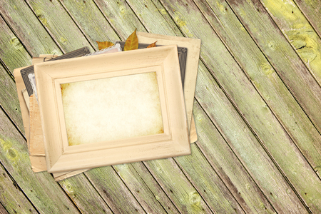 Vintage photoframes on old wooden planks. Mock up template. Copy space for your text