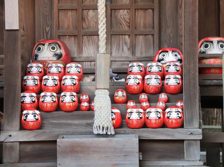 Traditional japanese daruma dolls in a shrine, Kurashiki city, Japan Stock Photo