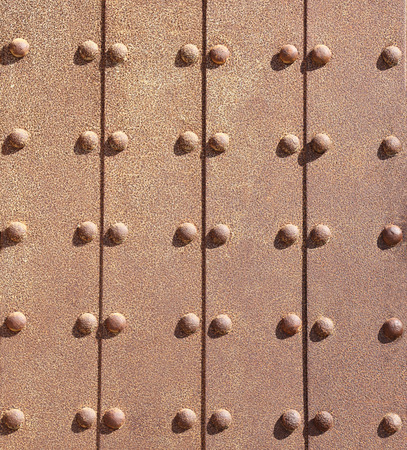 Grunge background - rusty metal texture with rivets