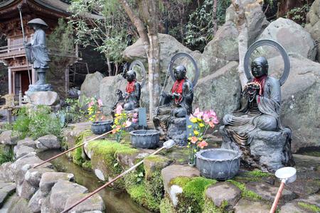 Temizuya - water basin for ritual ablution in Daishouin (Daishou-in) Buddhist temple, sacred Miyajima Island, Hiroshima prefecture, region Chugoku, Japan Stock Photo